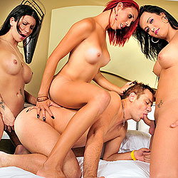 Three horny shemales gangbang a guy.